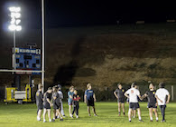 Rugby team practicing at night
