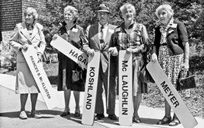 frances mcallister holding a sign saying frances b. mcallister; ella barrows hagar, widow of regent gerald hagar, holding a sign saying hagar; regent daniel koshland holding a sign saying koshland; sylvia mclaughlin, widow of regent donald mcLaughlin holding a sign saying mclaughlin; and virginia meyer, widow of regent theodore meyer holding a sign saying meyer