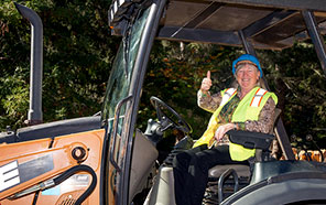 Alison Galloway, campus provost and executive vice chancellor, sitting in a tractor