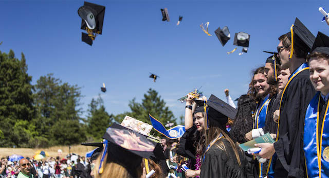 2017 UC Santa Cruz graduates throw their hats in the air in celebration of their commencement ceremony