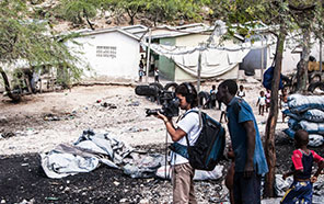 Juan Mejia filming the charcoal market in Ravin Djab, Haiti, very close to the Dominican border city of Jimani