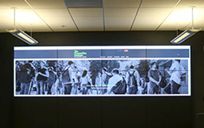 Image of the VizWall, a 14 by 4 foot screen installation.