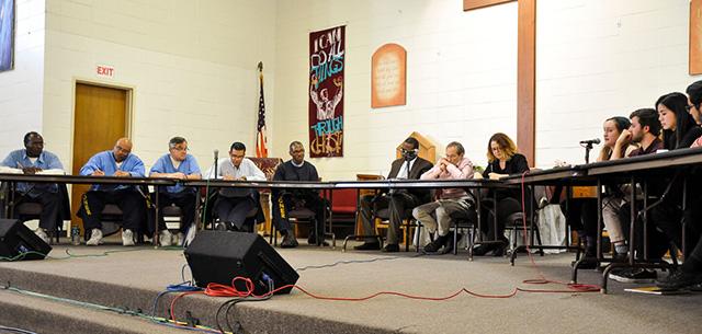 The San Quentin debate team and the UC Santa Cruz debate team.